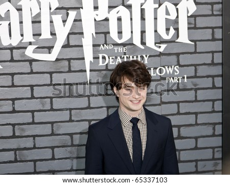 NEW YORK - NOVEMBER 15: Actor Daniel Radcliffe attends the premiere of 'Harry Potter and the Deathly Hallows - Part 1' at Alice Tully Hall on November 15, 2010 in New York City. - stock photo
