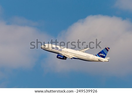 NEW YORK - NOVEMBER 3: Airbus A320 JetBlue approaches JFK Airport in New York, NY on November 3, 2013. A320 was the first narrow body airliner from Airbus. It is the biggest competition to Boeing 737. - stock photo