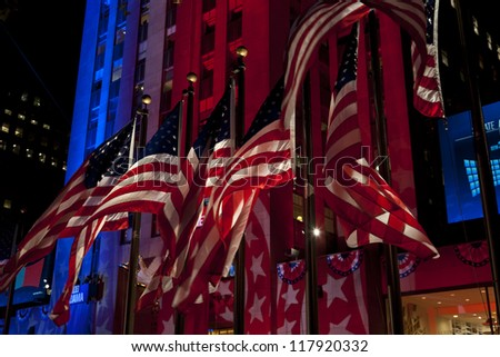 NEW YORK - NOVEMBER 06: American flags illuminated on 2012 Election day Presidential election on Rockefeller plaza on democracy Plaza sponsored by Microsoft on November 06, 2012 in NYC