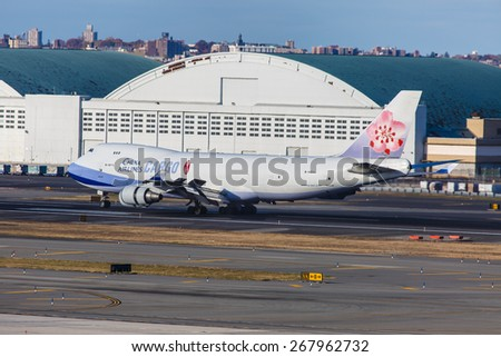 NEW YORK - NOVEMBER 3: Boeing 747 China Airlines lines up at JFK Airport in New York, USA on November 3, 2013. China Airlines is the flag carrier of the Republic of China, commonly known as Taiwan. - stock photo