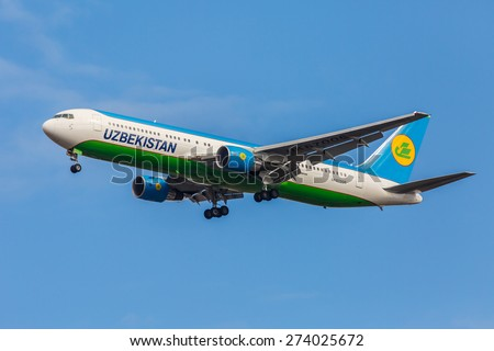 NEW YORK - NOVEMBER 3: Boeing 767 Uzbekistan Airways takes off from JFK International Airport in New York, NY on November 3, 2013. JFK Airport is rated 4th biggest American Airport in the world. - stock photo