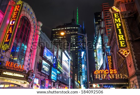 NEW YORK - NOVEMBER 22, 2013: Broadway by night,Manhattan.Broadway is one of the world's busiest pedestrian intersections and a major center of the world's entertainment industry. - stock photo