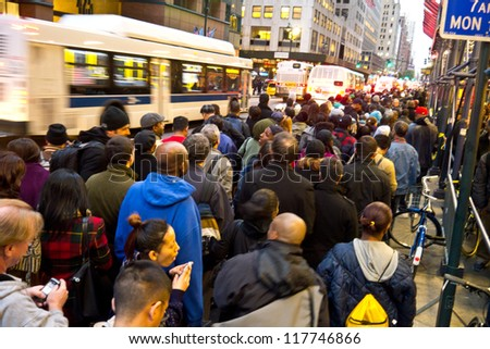 NEW YORK - NOVEMBER 2:  Commuters wait in long lines for Bus service around Grand Central post Hurricane Sandy November 2, 2012 in New York City. - stock photo