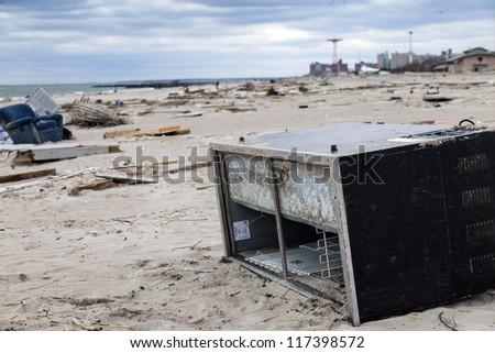 NEW YORK - NOVEMBER 1, 2012: Debris on the Brighton Beach after Hurricane Sandy hit Brooklyn area on November 1, 2012, Brooklyn, NY - stock photo