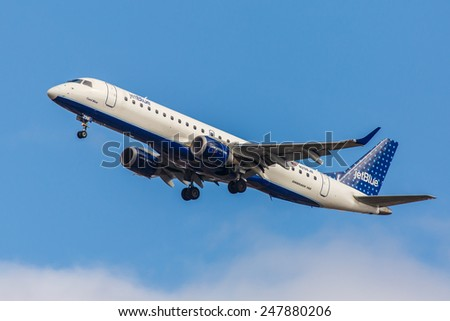NEW YORK - NOVEMBER 3: Embraer 190 JetBlue departs from JFK Airport in New York, NY on November 3, 2013. JetBlue is New York based, fastest growing airline in the world. - stock photo