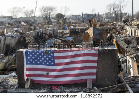 NEW YORK -NOVEMBER 12: Fire destroy around 100 houses during Hurricane Sandy in the flooded neighborhood at Breezy Point in Far Rockaway area  on November 12, 2012 in New York City; NY - stock photo