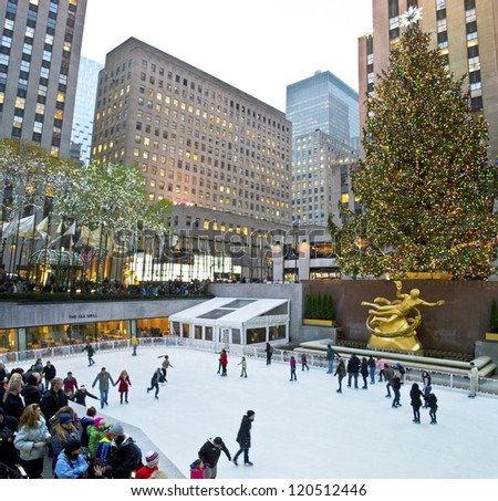 NEW YORK - NOVEMBER 30: Ice skaters and tourists are all around the famous Rockefeller Center Christmas tree on November 30, 2012 in New York City. - stock photo