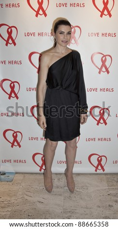 NEW YORK - NOVEMBER 09: Julianna Margulies attends Love Heals The Alison Gertz Foundation For AIDS Education 20th Anniversary gala at the Four Seasons Restaurant on November 9, 2011 in New York City, NY.. - stock photo