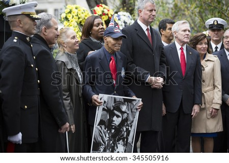 NEW YORK - NOVEMBER 11 2015: Roscoe Brown, 93, pilot with famed Tuskegee Airmen with other VIP at the Eternal Light Monument in Madison Square Park before the Americas Parade on Veterans Day. - stock photo