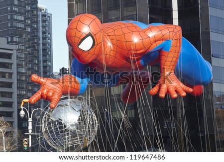 NEW YORK - NOVEMBER 22: Spiderman balloon is flown at the 86th Annual Macy's Thanksgiving Day Parade on November 22, 2012 in New York City. - stock photo