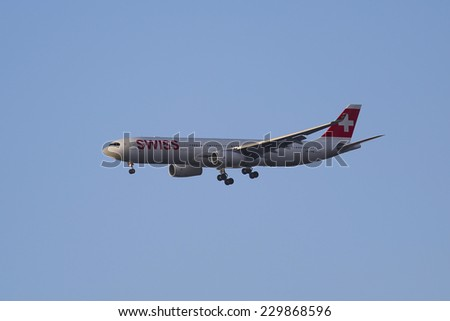 NEW YORK - NOVEMBER 11: Swissair Airbus A330 in New York sky before landing at JFK Airport on November 11, 2014. Swiss International Air Lines is the flag carrier airline of Switzerland - stock photo