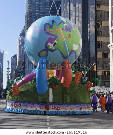 NEW YORK - NOVEMBER 28: The Earth balloon flown at the 87th Annual Macy's Thanksgiving Day Parade on November 28, 2013 in New York City.
