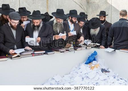 NEW YORK - NOVEMBER 6: Ultra Orthodox Jewish men pray at the Ohel in New York, NY on November 6, 2015. The Ohel is where Rabbi Menachem Schneerson was laid to rest next to Rabbi Yosef Y. Schneersohn. - stock photo