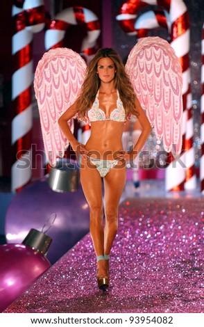 NEW YORK - NOVEMBER 9: Victoria's Secret Fashion model Alessandra Ambrosio walks the runway during the 2010 Victoria's Secret Fashion Show on November 9, 2005 at the Lexington Armory, New York City. - stock photo