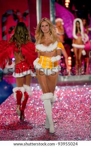 NEW YORK - NOVEMBER 9: Victoria's Secret Fashion model Karolina Kurkova walks the runway during the 2010 Victoria's Secret Fashion Show on November 9, 2005 at the Lexington Armory in New York City.