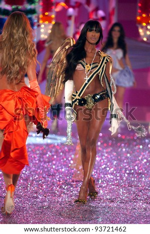 NEW YORK - NOVEMBER 9: Victoria's Secret Fashion model  Naomi Campbell walks the runway during the 2010 Victoria's Secret Fashion Show on November 9, 2005 at the Lexington Armory in New York City.