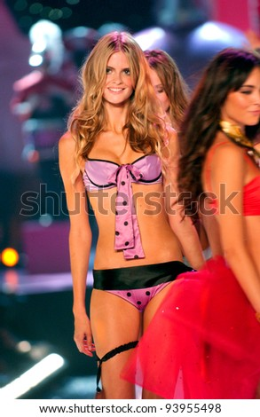 NEW YORK - NOVEMBER 9: Victoria's Secret Fashion models walks the runway finale during the 2010 Victoria's Secret Fashion Show on November 9, 2005 at the Lexington Armory in New York City.