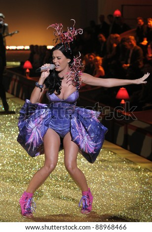 NEW YORK - NOVEMBER 10: Victoria's Secret Fashion Show singer Katy Perry sings at runway during the 2010 Victoria's Secret Fashion Show on November 10, 2010 at the Lexington Armory in New York City. - stock photo