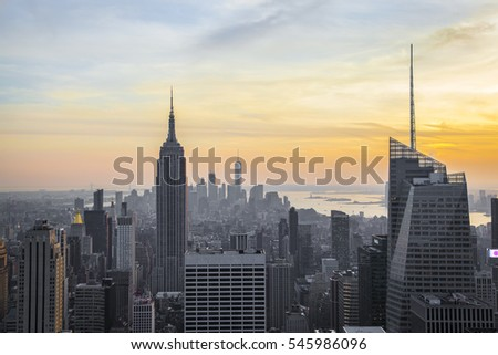 NEW YORK - NOVEMBER 26, 2016,View of Manhattan and the Empire State Buolding sunset from Rockefeller Building roof