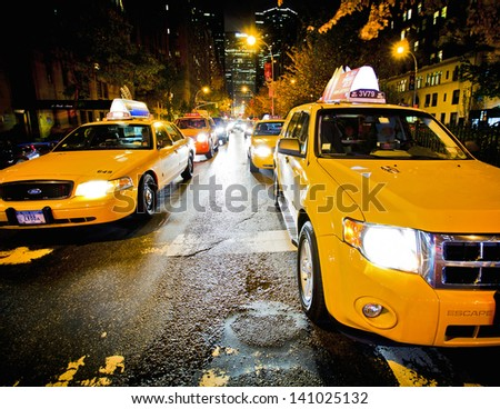 NEW YORK - NOVEMBER 11: Yellow NYC taxi cab in New York City on November 11, 2011. The taxicabs of New York City are a widely recognized icon of the city. - stock photo