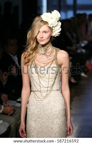 NEW YORK, NY - APRIL 12: A model walks the runway at the Iness di Santo Spring 2015 Bridal collection show at The Standard Hotel on April 12, 2014 in New York City. - stock photo