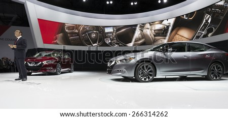 New York, NY - April 2, 2015: Chairman & CEO of Nissan Carlos Ghosn presents new Maxima at New York International auto show - stock photo