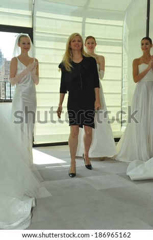NEW YORK, NY - APRIL 11: Designer Justina McCaffrey and models posing for presentation during the Justina McCaffrey Spring 2015 Bridal collection show at on April 11, 2014 in New York City.