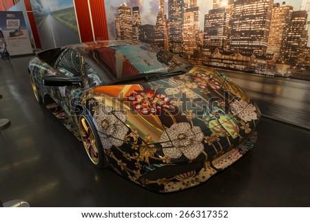 New York, NY - April 2, 2015: Exterior of painted Lamborghini sport car on display at New York International Auto Show at Javits Center - stock photo