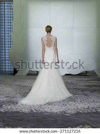 New York, NY - April 17, 2015: Model walks runway for Rivini wedding collection by Rita Vinieris bridal collection at Park Hyatt hotel Onyx Room - stock photo