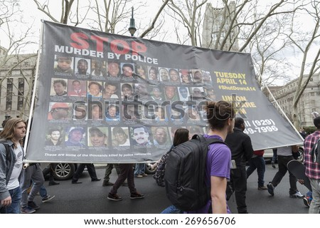 New York, NY - April 14, 2015: Protesters against police brutality walk down around Foley Square - stock photo