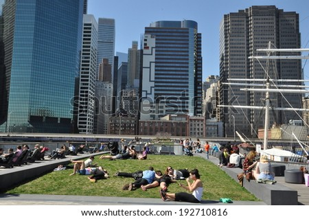 NEW YORK, NY - APRIL 12: South Street Seaport in Manhattan, New York, as seen on April 12, 2014. It located where Fulton Street meets the East River, and adjacent to the Financial District. - stock photo