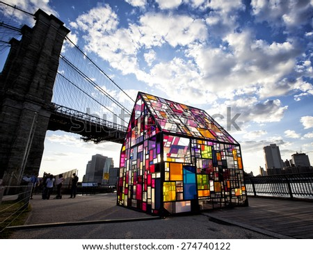 NEW YORK, NY - APRIL 29, 2015: Tom Fruins, Kolonihavehus, famous stained glass house in Brooklyn Bridge Park, NYC. - stock photo