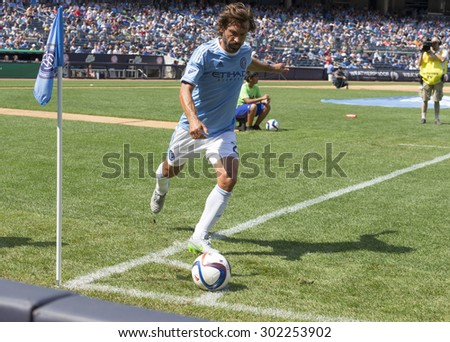New York, NY - August 1, 2015: Andrea Pirlo performs corner kick during game between New York City FC and Montreal Impact at Yankee Stadium - stock photo