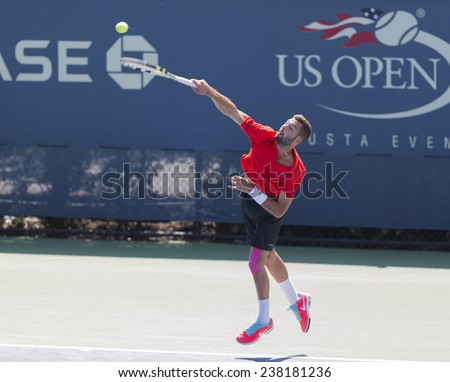 NEW YORK, NY - AUGUST 25: Benoit Paire of France serves ball during 1st round match against Julien Benneteau of France at US Open tennis tournament in Flushing Meadows USTA Tennis Center 2014