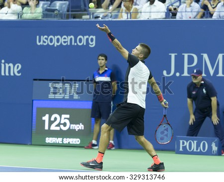 New York, NY - August 31, 2015: Borna Coric of Croatia serves during 1st round match against Rafael Nadal of Spain at US Open Championship - stock photo