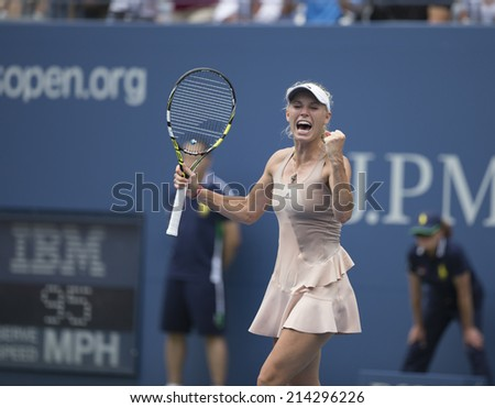 NEW YORK, NY - AUGUST 31, 2014: Caroline Wozniacki of Denmark celebrate victory of 4th round match against Maria Sharapova of Russia at US Open tennis tournament in Flushing Meadows USTA Tennis Center - stock photo