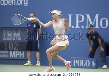 NEW YORK, NY - AUGUST 31, 2014: Caroline Wozniacki of Denmark returns ball during 4th round match against Maria Sharapova of Russia at US Open tennis tournament in Flushing Meadows USTA Tennis Center - stock photo