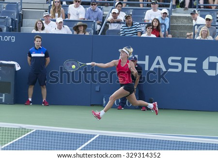 New York, NY - August 31, 2015: Coco Vandeweghe of USA returns ball during 1st round match against Sloane Stephens of USA at US Open Championship  - stock photo
