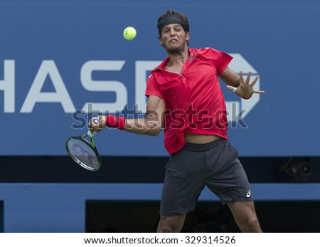 New York, NY - August 31, 2015: Joao Souza of Brazil returns ball during 1st round match against Novak Djokovic of Serbia at US Open Championship  - stock photo