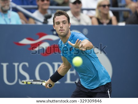 New York, NY - August 31, 2015: Marco Cecchinato of Italy returns ball during 1st round match against Mardy Fish of USA at US Open Championship  - stock photo