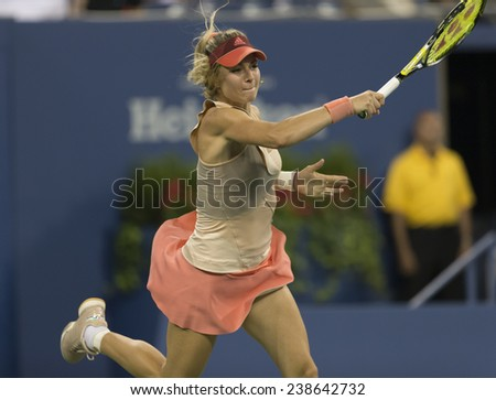 NEW YORK, NY - AUGUST 25: Maria Kirilenko of Russia returns ball during 1st round match against Maria Sharapova of Russia at US Open tennis tournament in Flushing Meadows USTA Tennis Center 2014 - stock photo