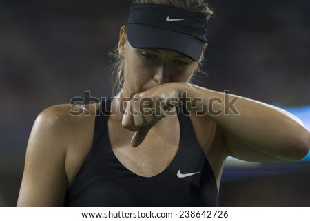 NEW YORK, NY - AUGUST 25: Maria Sharapova of Russia reacts during 1st round match against Maria Kirilenko of Russia at US Open tennis tournament in Flushing Meadows USTA Tennis Center 2014 - stock photo