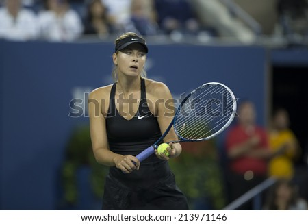 NEW YORK, NY - AUGUST 29, 2014: Maria Sharapova of Russia returns ball during 2nd round match against Sabine Lisicki of Germany at US Open tennis tournament in Flushing Meadows USTA Tennis Center