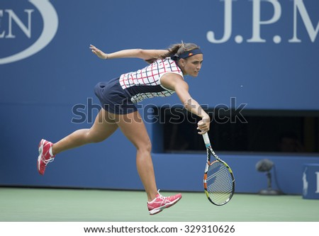 New York, NY - August 31, 2015: Monica Puig returns ball during 1st round match against Venus Williams of USA at US Open Championship - stock photo
