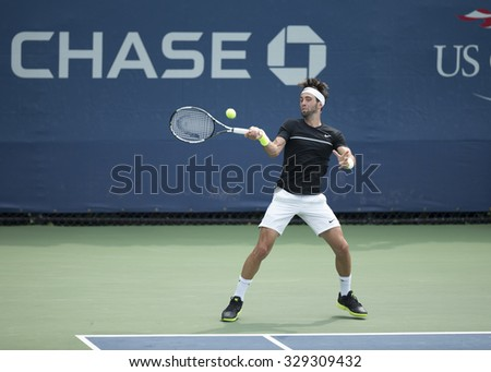 New York, NY - August 31, 2015: Nikoloz Basilashvili of Georgia returns ball during 1st round match against Feliciano Lopez of Spain at US Open Championship