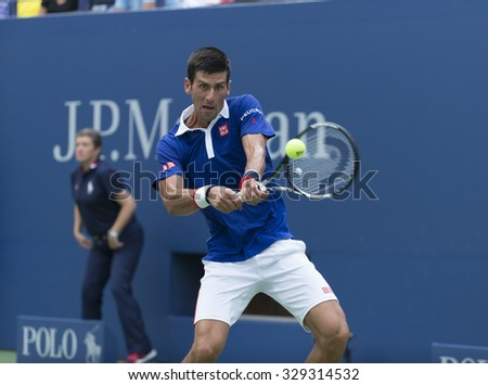 New York, NY - August 31, 2015: Novak Djokovic of Serbia returns ball during 1st round match against Joao Souza of Brazil at US Open Championship  - stock photo