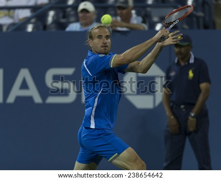 NEW YORK, NY - AUGUST 28: Peter Gojowczyk of Germany returns ball during 2nd round match against Milos Raonic of Canada at US Open tennis tournament in Flushing Meadows USTA Tennis Center 2014 - stock photo
