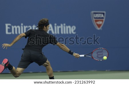 NEW YORK, NY - AUGUST 29, 2014: Roger Federer of Switzerland returns ball during 2nd round match against Sam Groth of Australia at US Open tennis tournament in Flushing Meadows USTA Tennis Center - stock photo