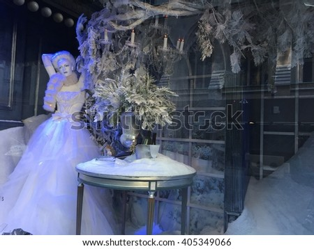 NEW YORK, NY - DEC 20: Holiday window display at Saks Fifth Avenue in New York, as seen on Dec 20, 2015. This is the flagship store and attracts tourists in the holiday season for its window displays. - stock photo