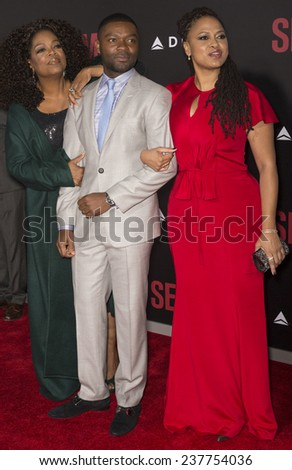 NEW YORK, NY - DECEMBER 14, 2014: (L-R) Actors Oprah Winfrey, David Oyelowo and director Ava DuVernay attend the 'Selma' New York Premiere at the Ziegfeld Theater - stock photo